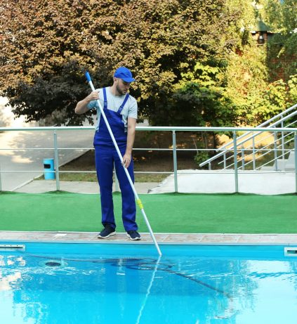Male,Worker,Cleaning,Outdoor,Pool,With,Scoop,Net